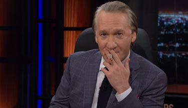 Bill-Maher-Lights-Up-A-Joint-and-Discusses-Pot-Problem-In-America-sm