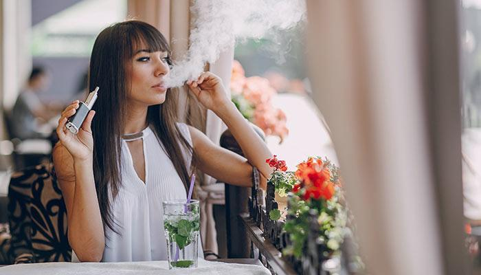 Young-Lady-Vaporizing-In-Public